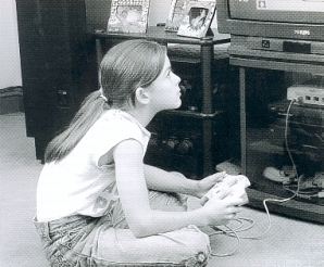 Girl playing computer game