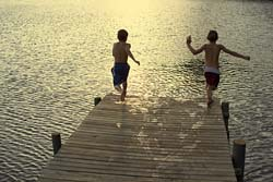 Two boys jumping off dock - Facing Your Fears - Going Deeper with God